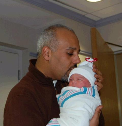 Mo Elleithee holding his newly-born daughter, Sadie Isabella Elleithee on his hands.