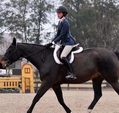Sophia Strahan riding a horse.
