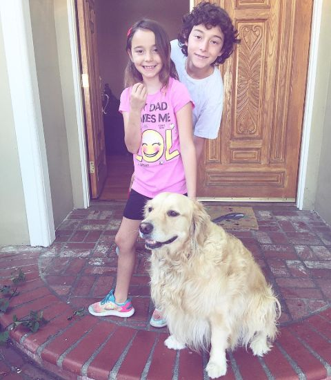 Wyatt and his sister with their dog.