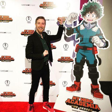 Justin Briner alongside Deku's life-size paper cut out.