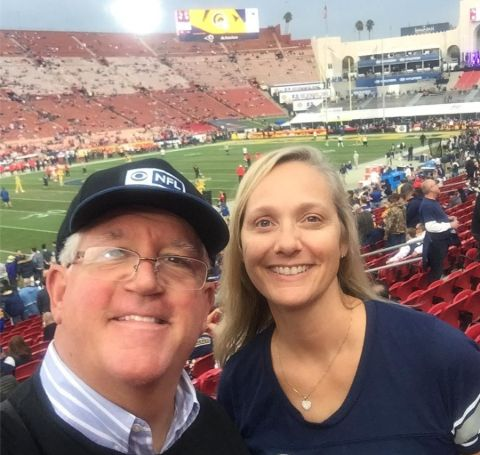 Gregory and his wife, Julie Jbara at a rugby game.