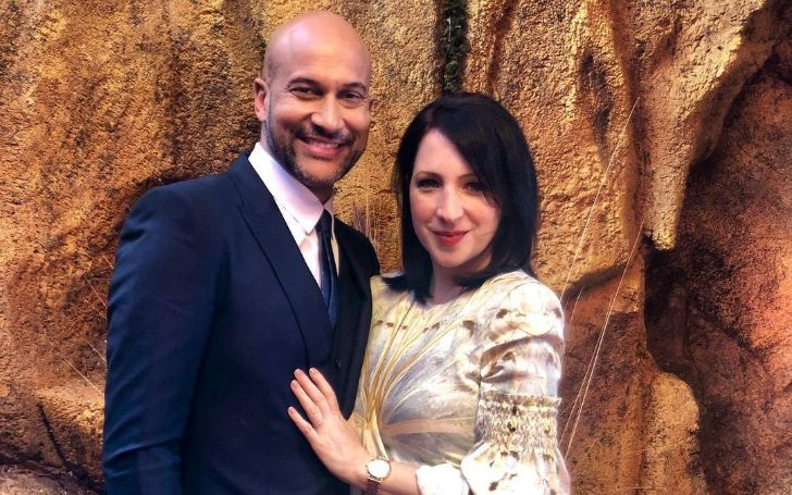 A photo of Elisa Pugliese and Keegan-Michael Key at the Lion King premiere.