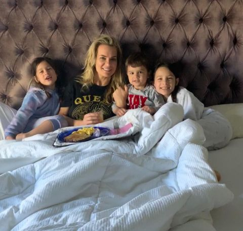 Jackie Ibanez and her kids on their bed.