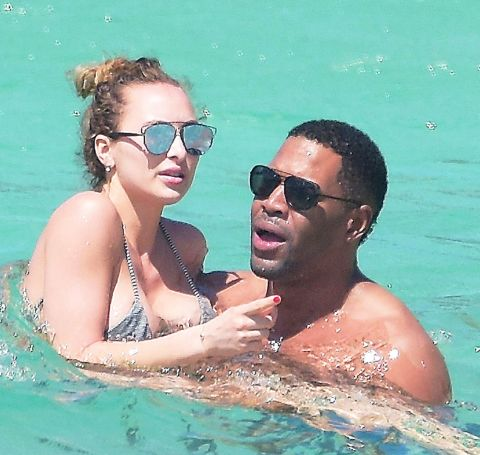 Kayla Quick and Michael Strahan cooling off in the water.
