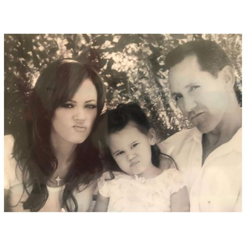 Sofia with her parents during childhood.