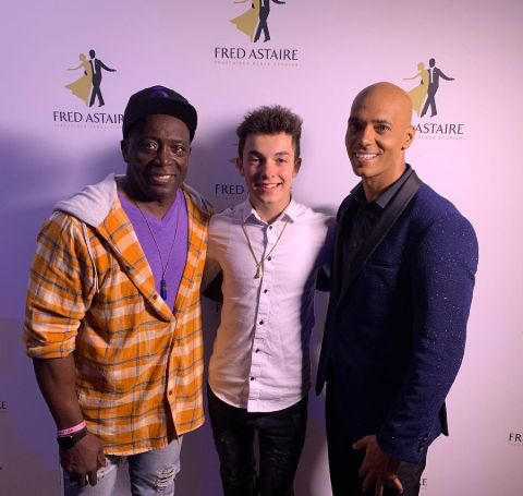 Billy Blanks' son and grandson at an event.