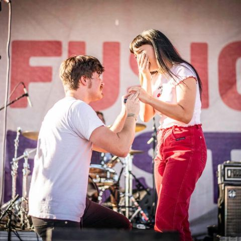 Jakob Nowell proposing his fiancee on stage.