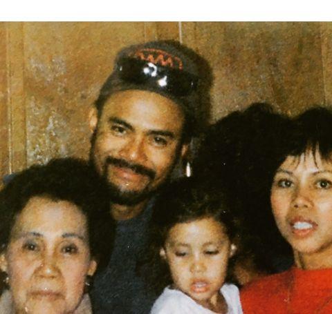 Troy Dendekker with her parents.