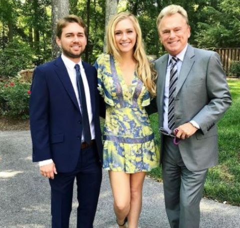 Maggie with her brother and father.