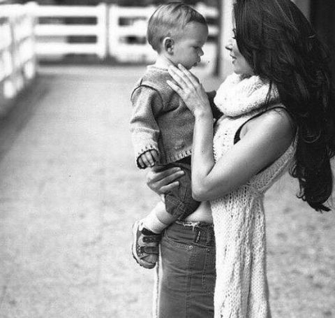 Shania Twain holding his son, Eja Lange.